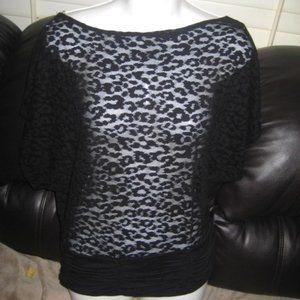 black design black sleeve top